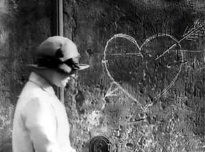 1926 Movie still heart on wall woman